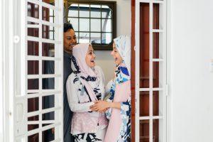 two-women-standing-by-the-door-1071968