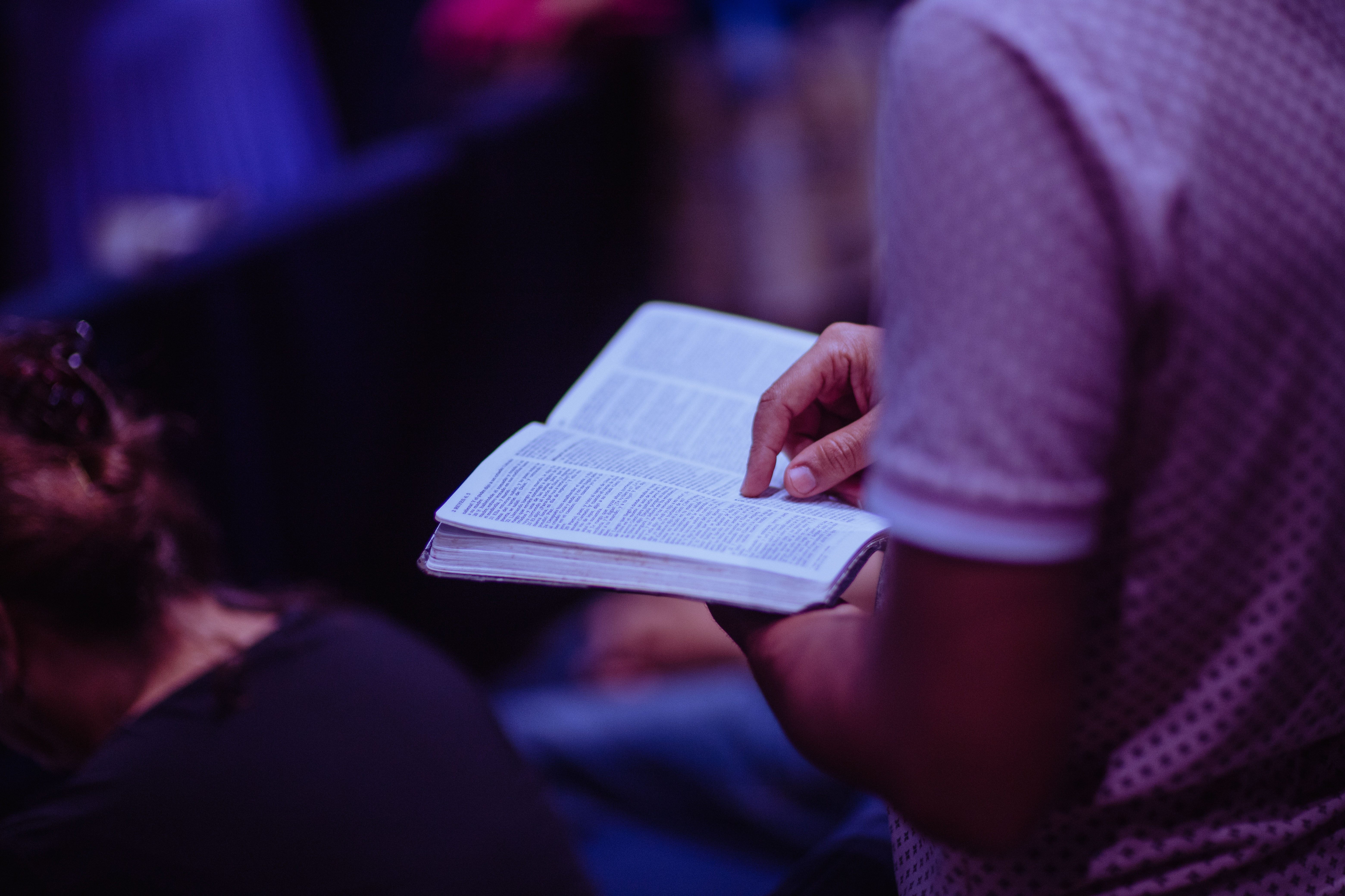 selective-focus-photo-of-person-holding-book-2351719